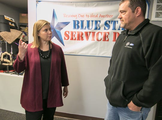 U.S. Rep. Elissa Slotkin talks with Jason Schiffman from the UAW Ford Community Outreach Program at Blue Star Service Dogs of Hamburg Township Monday, Dec. 9, 2019.