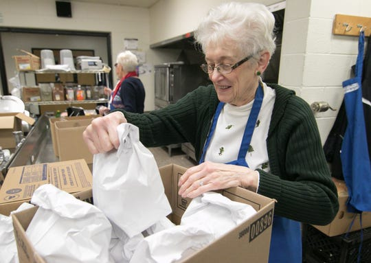 Darlene Dockery packages breakfasts for seniors at Meals on Wheels Monday, Dec. 9, 2019.