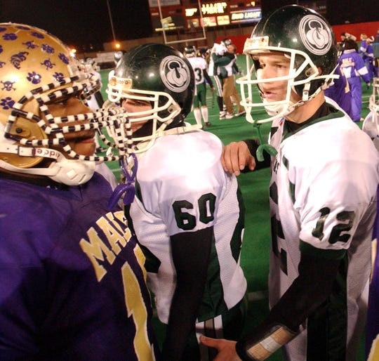 Trinity quarterback Brian Brohm extended a hand to Male quarterback Michael Bush after yesterday's state title game.