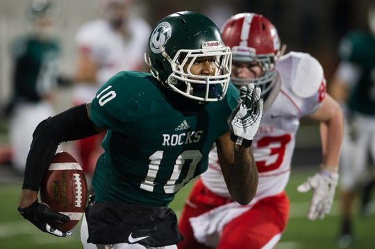 Trinity's Rodjay Burns runs upfield during the Shamrocks KHSAA Commonwealth Gridiron Bowl game against Dixie Heights at Western Kentucky University in Bowling Green, KY on Saturday, December 6, 2014. Trinity would go on to win 47-14.