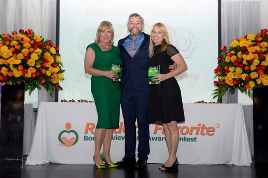 """Local authorsKate Jungwirth and Deborah Erdmann recently attended the Readers' Favorite International Award ceremony in Miami, where they received an award for """"Alien Invasion,"""" the third book in theirMystery at Point Beachseries."""