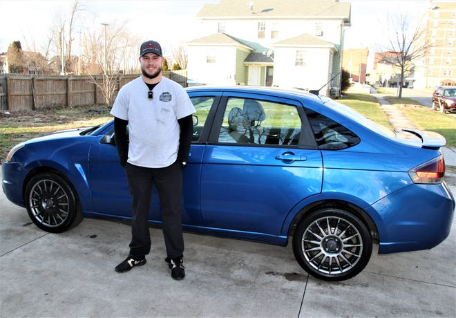 Brandon Ballinger, owner and founder of Ballinger Detailing, shows off a freshly-cleaned vehicle he worked on last Friday. Ballinger, 25, left Honda after eight years to start his own business earlier in 2019. He hopes to find his own shop to work out of in the near future.