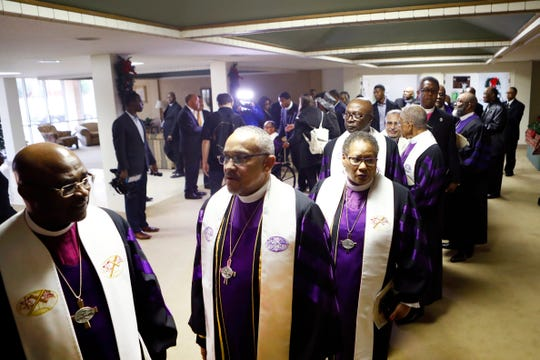Fellow clergy members gather to celebrate the life of Bishop William Graves, Sr., the 42nd Bishop of the Christian Methodist Episcopal Church, on Monday at Greenwood CME Church.