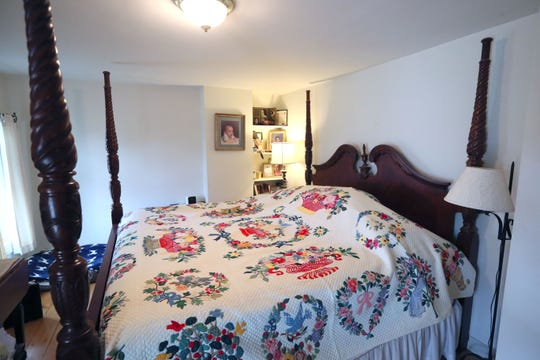 The master bed is dressed with a quilt made by Beth Jennings' mother.