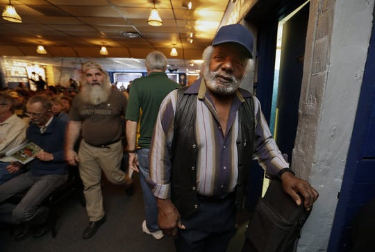 Kermit Stokes, a legendary blue artist in Milwaukee, died Dec. 3 at 77.  In this 2014 photo, Stokes waits at Shank Hall with his guitar to play during a celebration of Milwaukee blues harmonica great Jim Liban's 50 years of performing music.