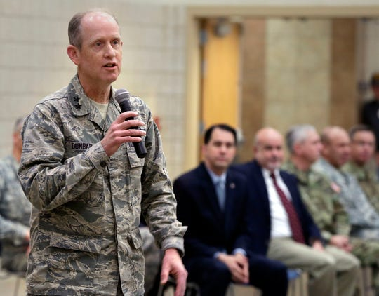 Major General Donald Dunbar, Adjutant General, thanks families for their sacrifice during a sendoff ceremony for 65 Wisconsin Army National Guard members from Detachment 1, Headquarters, 101st Airborne Division Multi-Component Unit. There ceremony was held at the Armed Forces Reserve Center in Madison, Wisconsin, Monday, January 4, 2016.