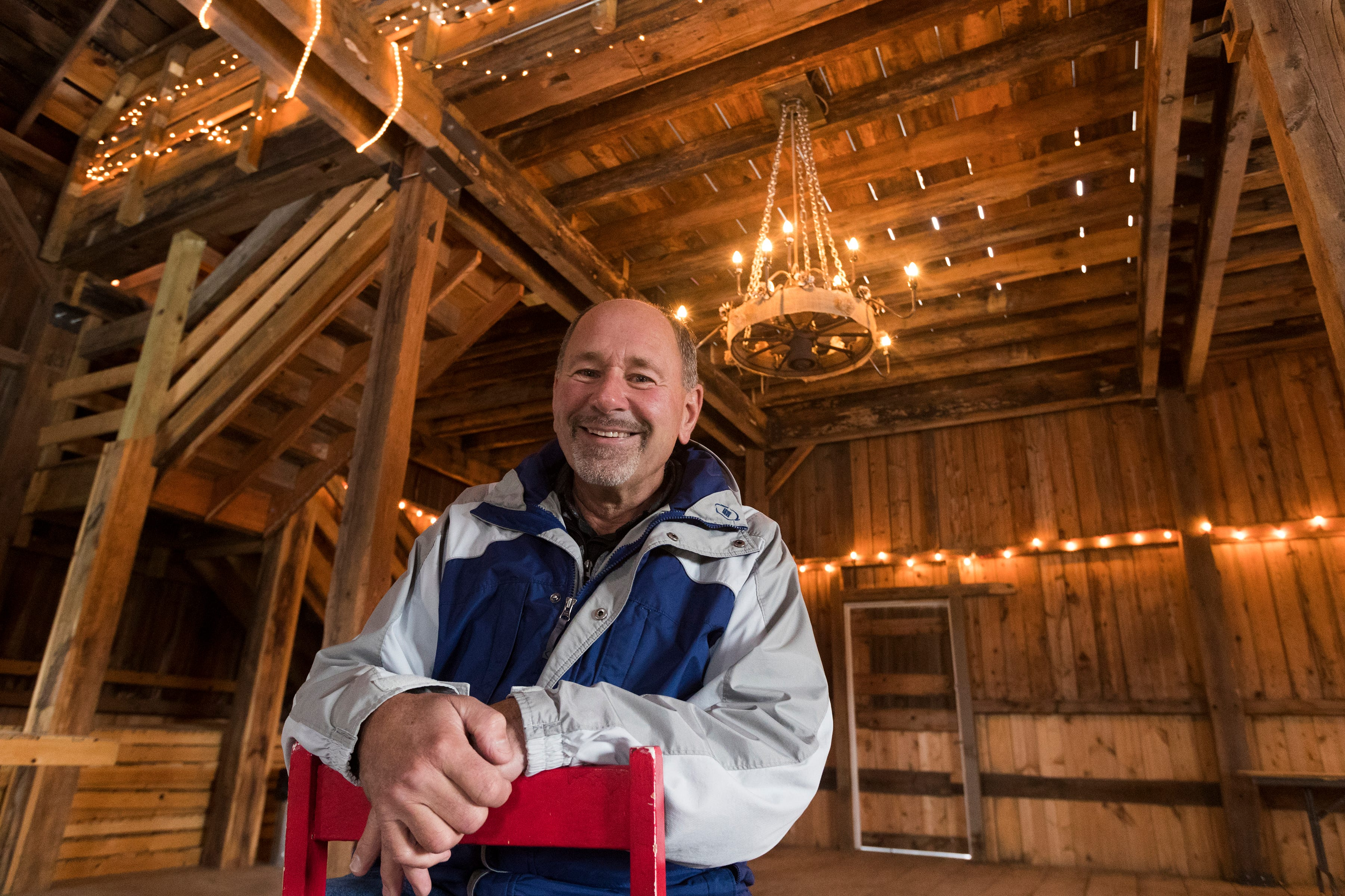 Former dairy farmer Greg Zwald inside of the renovated barn he uses as an event space at his White Pine Berry Farm outside River Falls.