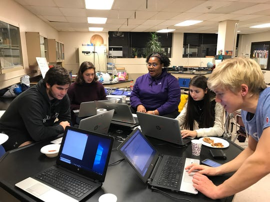 The Cyber Security team downloads data to compete in Round 2 of the national CyberPatriot competition along with seniors Antti Meriluotto and Logan Blankinship.  This is the first year the team competes.