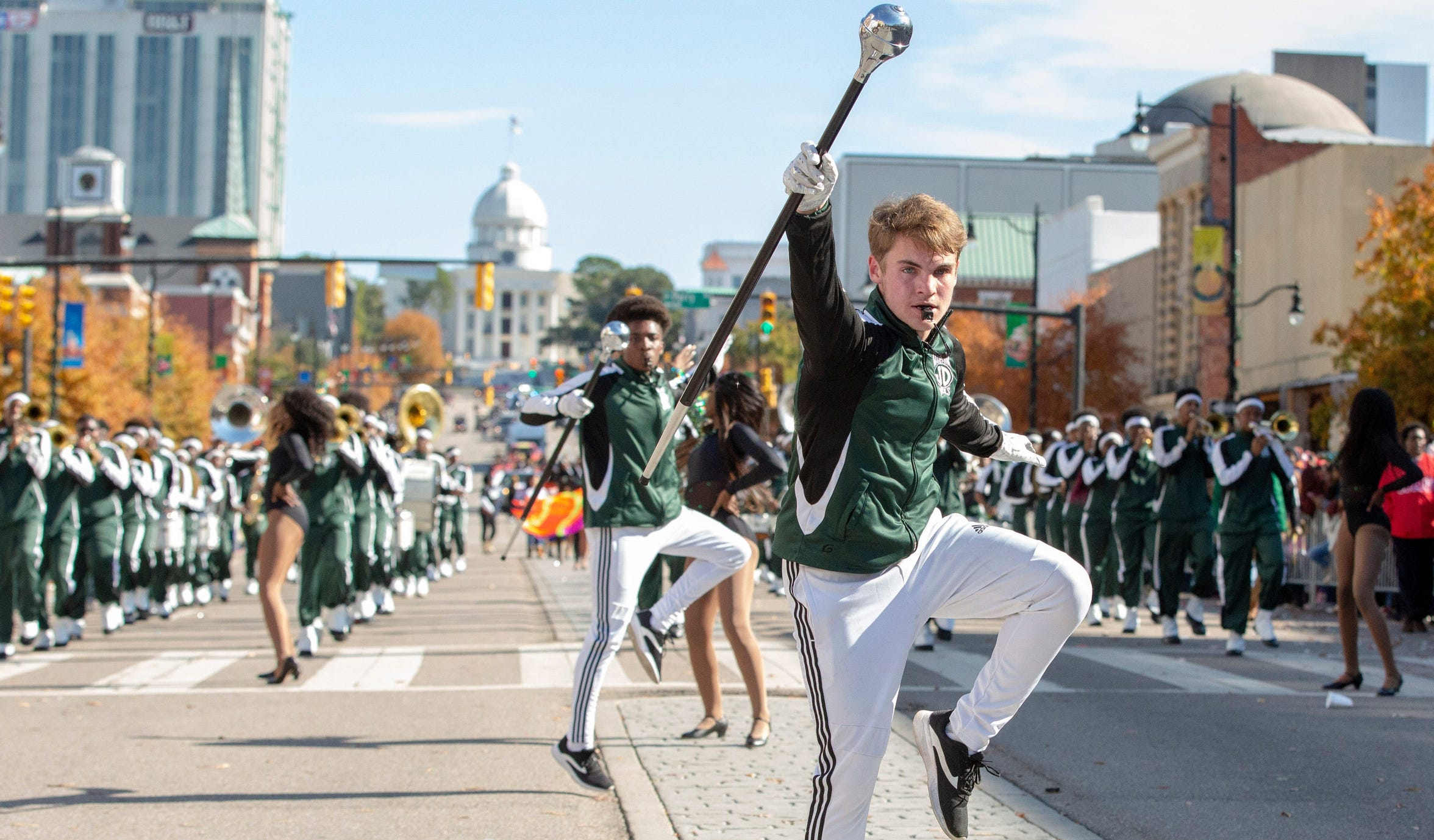 Justin Heideman, lead drum major who went viral recently, leads his Jeff Davis band down Dexter Avenue to the shouts of many adoring fans.