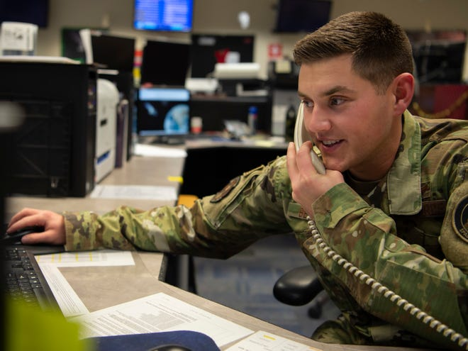 Airman 1st Class William Beattie, 4th Space Operations Squadron Advanced Extremely High Frequency satellite mission control sub-systems operator, communicates with a mobile ASMCS operator at Schriever Air Force Base, Colorado, Dec. 5, 2019. Beattie was recently selected for Air Force officer training school at Maxwell AFB, Alabama, Feb. 11, 2020, and will commission as a space officer.
