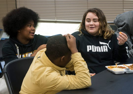Maddy Moore enjoys lunch with friends at Accel Day and Evening Academy in Mobile, Ala., on Wednesday, Dec. 4, 2019.