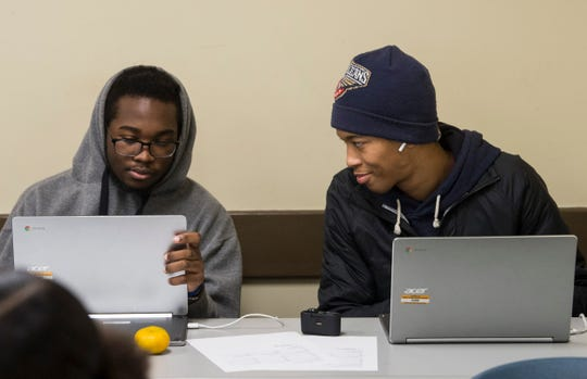 Brian Anthony, right, works in class at Accel Day and Evening Academy in Mobile, Ala., on Wednesday, Dec. 4, 2019.