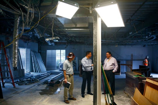 Carey Foley, Project Manager for EnviroStruct, from left Neil Simon, President of EnviroStruct, and Bill Ribble, Councilmember District 1, converse in the main chambers during a tour Wednesday, Jan. 27, 2016 at Estero City Hall. The two-floor, about 10,000 square-foot project, has a March 1 target date for completion. (Corey Perrine/Staff)