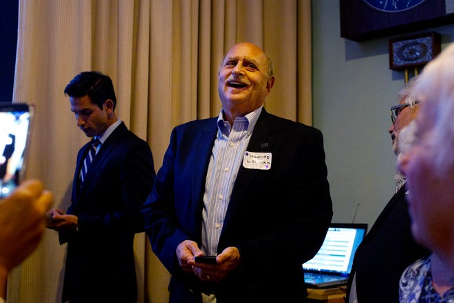 Howard Levitan, of the Estero Council of Community Leaders, watches election results come in at the Elks Lodge in Bonita Springs on Nov. 4, 2014. Estero residents overwhelmingly approved the incorporation of the Village of Estero. (Carolina Hidalgo/Staff)