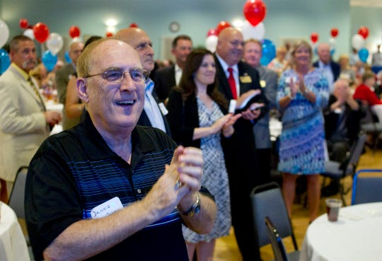 Attendes celebrate while watching results come in during an Estero Council of Community Leaders event to celebrate the incorporation of the Village of Estero on Nov. 4, 2014. (Carolina Hidalgo/Staff)
