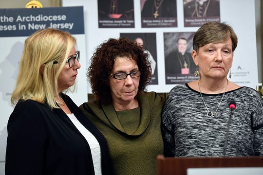 (from left) Micheline Esposito, Deborah Gonzalez, and Catherine McCormick tell their stories of being sexually abused by Father Augustine Giella during a press conference on Monday, Dec. 9, 2019, in Newark.