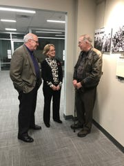 Book editors Ron Carver and Barbara Doherty talk with veteran Jan Barry at opening of Vietnam exhibit at Oakland Public Library