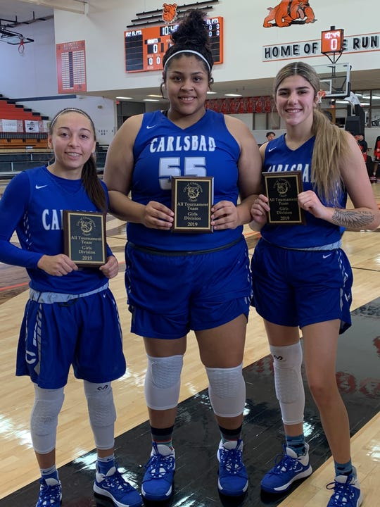Left to right: Carlsbad's Baylee Molina, Kaliyah Montoya and Teran Tiller display their All-Tournament Team plaques after winning the 2019 Artesia City of Champions Tournament on Dec. 7, 2019.