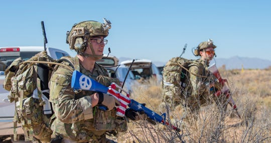 Tactical Air Control Party Airmen scan the surrounding area in Fort Bliss, Texas, Nov. 18, 2019. The new TACP Airmen performed tasks such as demonstrating small unit tactics skills, radio programming, and land navigation of a foreign terrain.