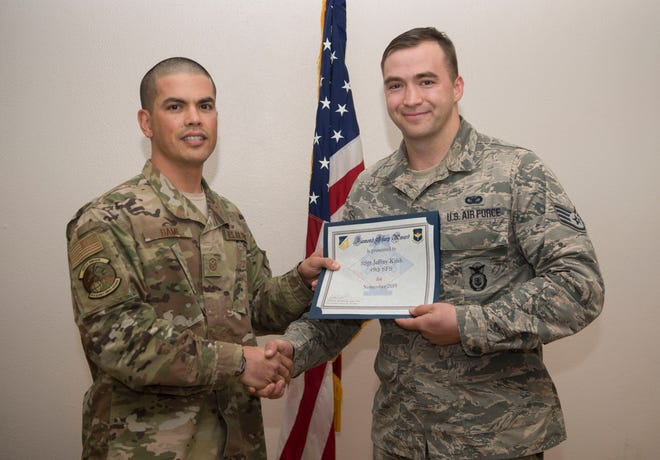 Staff Sgt. Jeffery Keith, 49th Security Forces Squadron communication and technology integration administrator, receives the Diamond Sharp Award from Master Sgt. Giles Dame, 49th SFS first sergeant, Dec. 3, 2019, on Holloman Air Force Base, N.M. Every month, a first sergeant has the honor of choosing a deserving Airman to be presented the Diamond Sharp Award for an outstanding act or continuous outstanding performance.