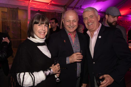 Susan Stein, Dr. Oscar Chamudes and Tom Truhe met up under the tent.