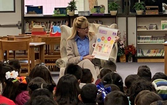 Sandie Newton presents the Speak Up Be Safe program to first graders.
