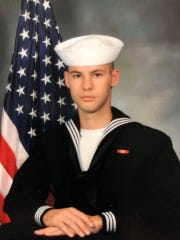 Cameron Scott Walters, 21, of Richmond Hill, Georgia, is photographed at Naval Air Station Pensacola some time between Nov. 24 and Dec. 5. Walters was one of the three Navy sailors killed on Friday, Dec. 6 when a suspect opened fire inside a building on the base.