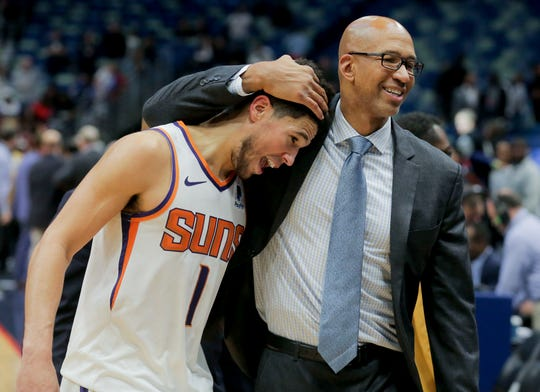 Phoenix Suns head coach Monty Williams embraces guard Devin Booker (1) as they leave the court following a 139-132 overtime win against the New Orleans Pelicans at the Smoothie King Center.