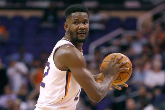 Phoenix Suns center Deandre Ayton (22) in the first half during a preseason NBA basketball game against the Minnesota Timberwolves, Tuesday, Oct. 8, 2019, in Phoenix. (AP Photo/Rick Scuteri)