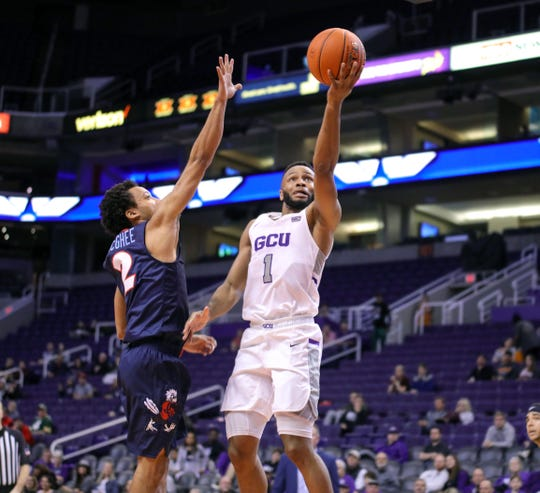 GCU Guard Isiah Brown (1) drives to the basket against Liberty Flames guard Darius McGhee (2) during the second half of the Air Force Reserve Jerry Colangelo Classic on Dec. 8, 2019 at Talking Stick Resort Arena in Phoenix, AZ. (Brady Klain/The Republic)