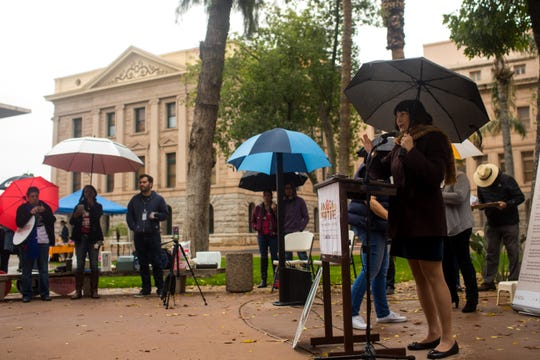 Toni Van Pelt, president of the National Organization for Women, speaks during a NOW rally demanding humane treatment of people, especially women, in immigration detention facilities Sunday, Dec. 9, 2019, at the Arizona State Capitol Building.