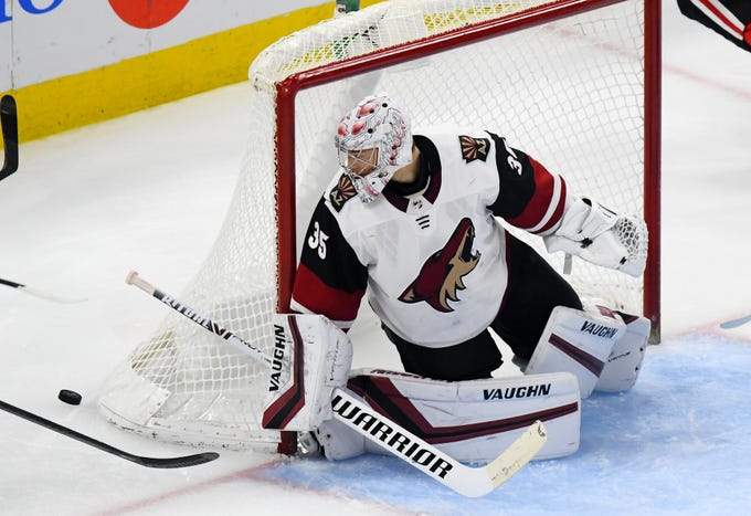 Dec 8, 2019; Chicago, IL, USA; Arizona Coyotes goaltender Darcy Kuemper (35) makes a save against the Chicago Blackhawks during the third period at the United Center. Mandatory Credit: Mike DiNovo-USA TODAY Sports