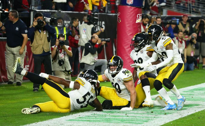 Pittsburgh Steelers outside linebacker T.J. Watt (90) reacts after intercepting a pass from Arizona Cardinals quarterback Kyler Murray (1) in the second half during a game on Dec. 8, 2019 in Glendale, Ariz.