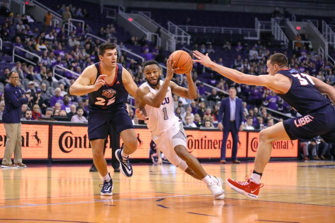 GCU Guard Isiah Brown (1) drives to the basket against the Liberty Flames in the Air Force Reserve Jerry Colangelo Classic on Dec. 8, 2019 at Talking Stick Resort Arena in Phoenix, AZ. (Brady Klain/The Republic)