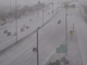 A blanket of hail covers State Route 51 near Union Hills Drive on on Dec. 9, 2019, after parts of the Phoenix area saw heavy rain and hail.