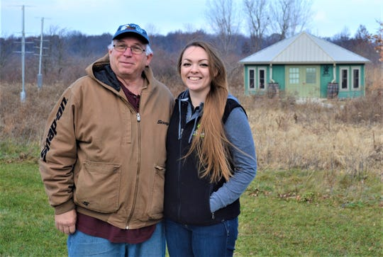 Volunteer Greg Sanderson and Aimee Arent, the executive director of Friends of the Ottawa National Wildlife Refuge, stand outside the refuge's visitor center on Dec. 6.