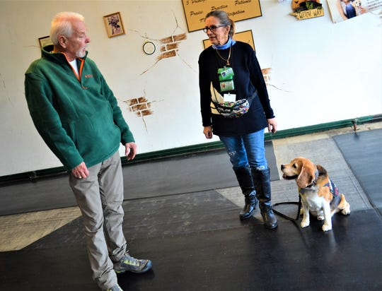 Oscar listens as his trainer, Nick Blackford, talks to him and his owner, DeeDee Kramer, at the North Coast training facility in Sandusky.
