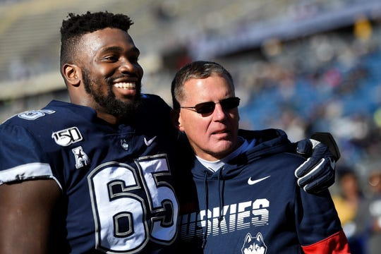UConn offensive lineman Matt Peart hugs Huskies head coach Randy Edsall during senior day on Saturday, Nov. 23. Edsall, a Susquehannock High School graduate, has received a vote of confidence from the school's athletic director.