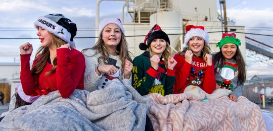 Members of the Fernley High School cheer team wait for the parade to begin.