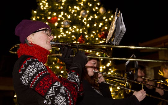 Jacquelyn Wardell, a Fernley High School band member, plays Christmas music with fellow band members Lillian Nattress, Wesley Carr and Seth Bake in front of the City Hall Christmas tree after the parade.