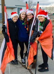 Fernley High School Color Guard members Kaelin Colony, Amber Moses, Vanessa Linarez and Briana Macedo, left to right, pose for a photo before the parade begins.