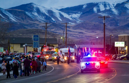 The 2019 Fernley Christmas parade approaches City Hall.