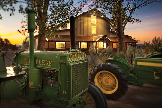 Vintage tractors idle in front of Frey Ranch Estate Distillery in Fallon, the family-owned outfit that produces vodka, gin, absinthe and, as of late 2019, a bourbon.