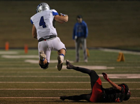 Richland Springs' Matthew Rigdon, left, hurdles a Strawn player during the Class 1A Division II state semifinal game in Abilene on Friday, Dec. 6, 2019.