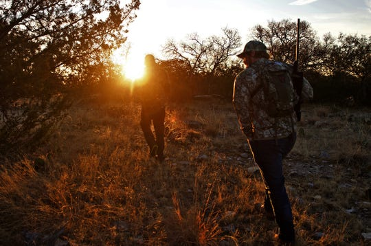 Marine Corps veteran Christopher Helms follows his guide, Ryan Dupriest, as they search for deer on a ranch near Christoval on Saturday, Dec. 7, 2019.