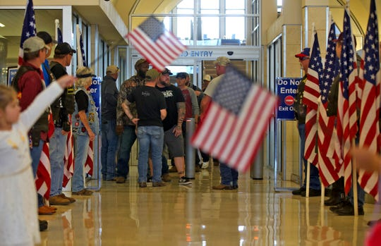 A group of veterans are greeted by supporters as they arrive at the San Angelo Regional Airport for the annual hunting weekend event sponsored by the San Angelo Support for Veterans organization on Wednesday, Dec. 4, 2019.