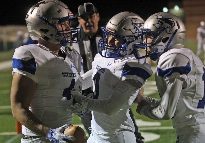 Matthew Rigdon, left, celebrates a touchdown with teammates during the Class 1A Division II state semifinal game against Strawn in Abilene on Friday, Dec. 6, 2019.