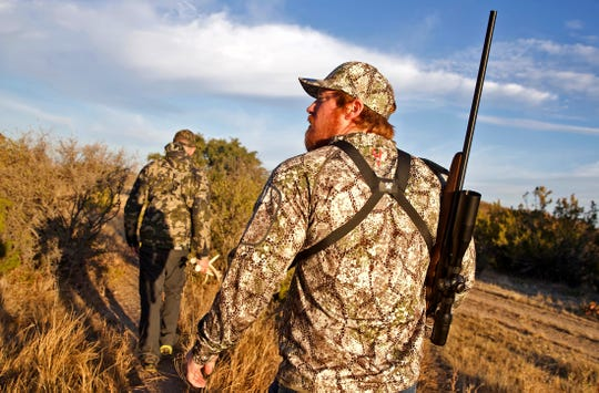Marine Corps veteran Christopher Helms keeps an eye out for deer on a ranch near Christoval as he is led by guide Ryan Dupriest on Saturday, Dec. 7, 2019.