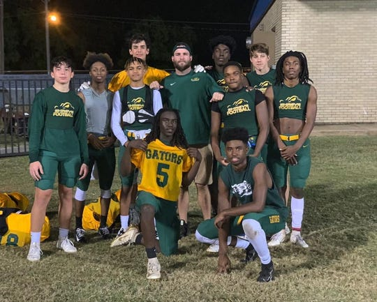 Captain Shreve assistant football coach Logan Allen (center standing) was killed in a vehicle accident Sunday.