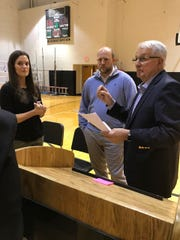 Master of ceremonies Ronnie Young, right, gives instructions to Amanda Caporelli Royals and Donovan Huffer before the induction ceremony into Buffalo Gap's hall of fame Friday night.